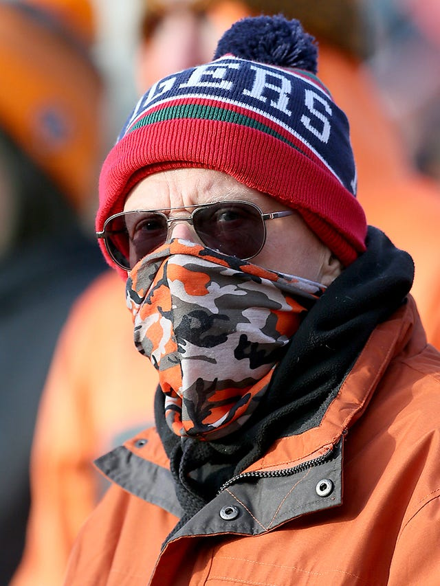 A Castleford supporter wears a mask at the Mend-A-Hose Jungle