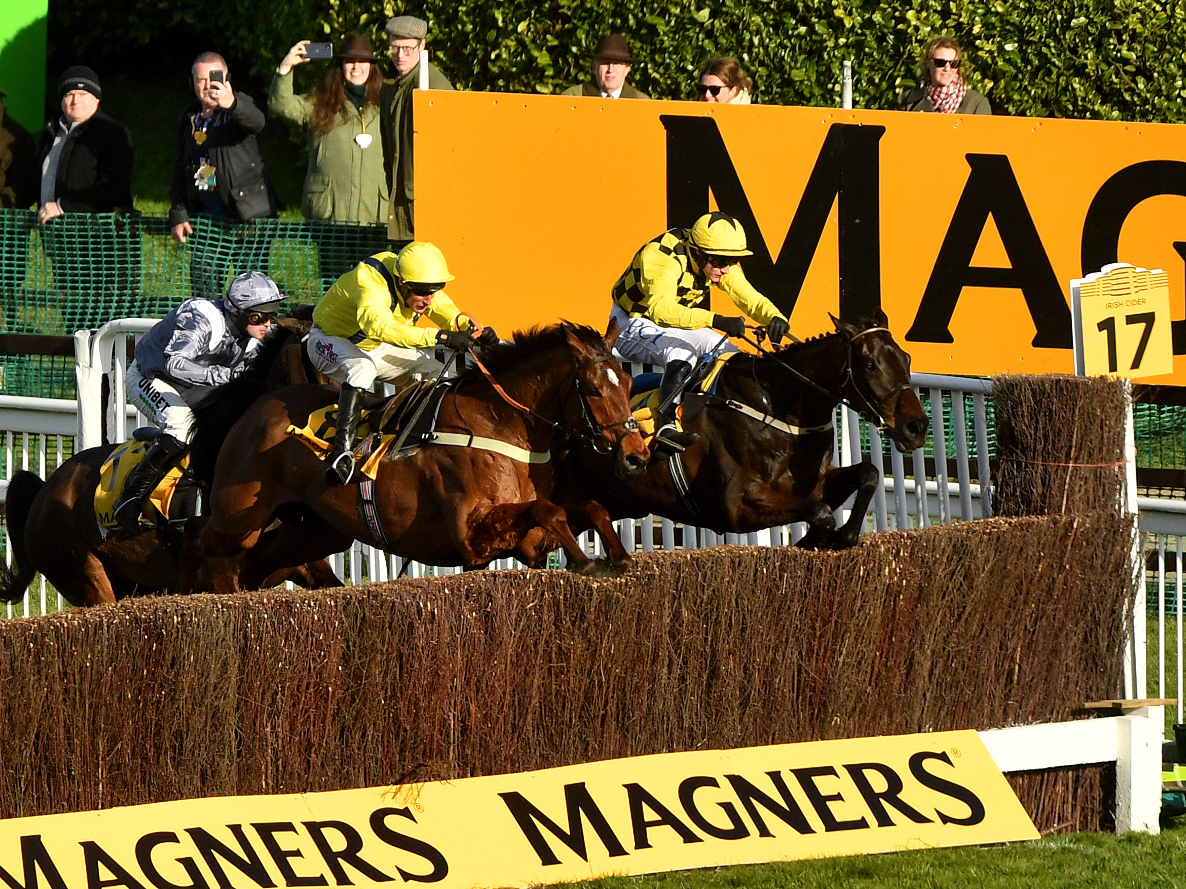 Al Boum Photo and Paul Townend (right) jump the last on the way to winning the 2020 Magners Cheltenham Gold Cup (Jacob King/PA)