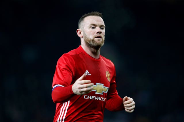 Wayne Rooney feels the mood at Old Trafford has already improved (Martin Rickett/PA).