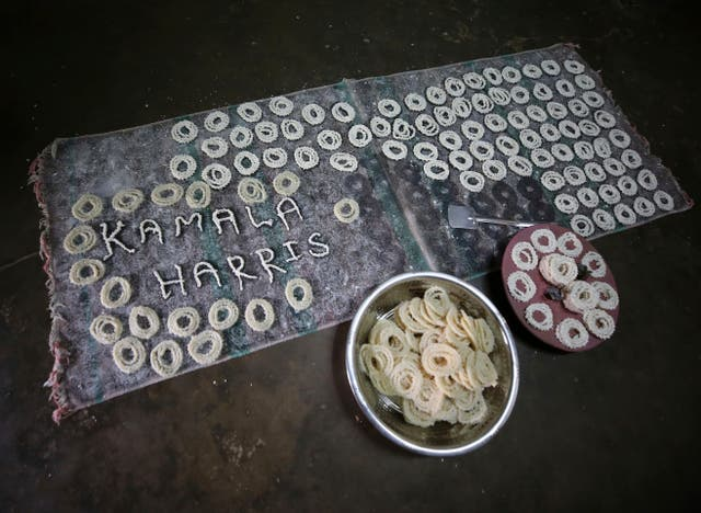 The name of US Vice President-elect Kamala Harris is made from ingredients of a local savory Murukku at a village house, in Thulasendrapuram (Aijaz Rahi/AP)