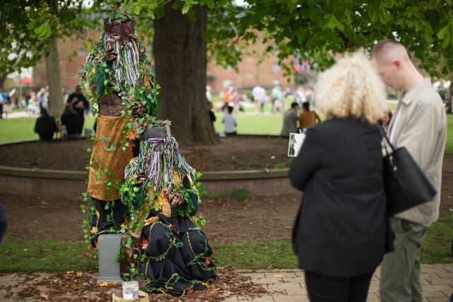 British and German performers The Greenmen perform for the public (Aaron Chown/PA)