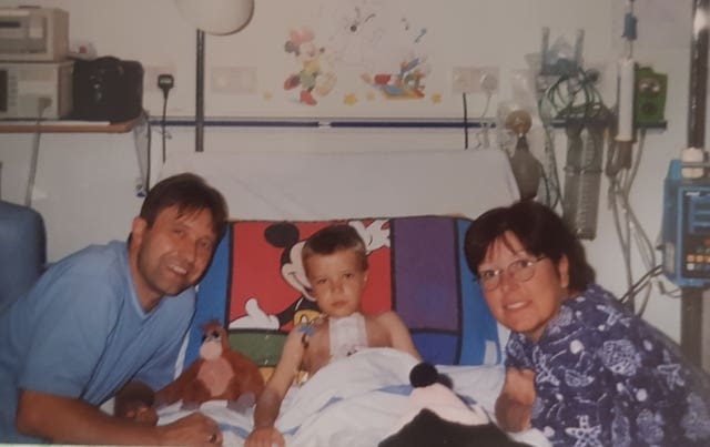 Tommy Frank with his parents Christine and Kevin