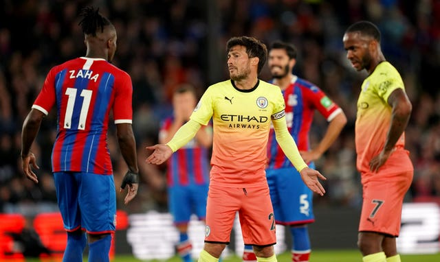 David Silva exchanges words with Crystal Palace's Wilfried Zaha