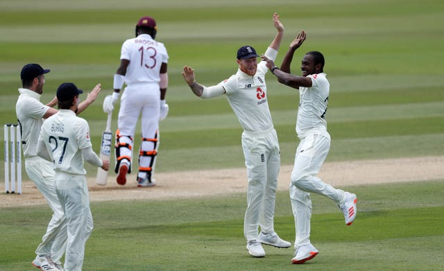 England's Jofra Archer, right, celebrates taking the wicket of West Indies' Shamarh Brooks