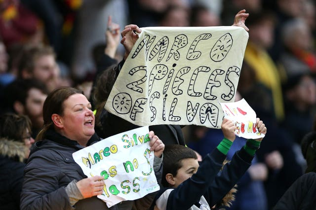 A fan holds up a sign reading 'Marco 2 pieces of Silva' on the Everton manager's return to Watford