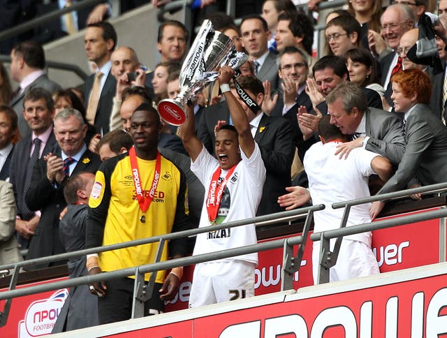 Scott Sinclair holds the Championship play-off trophy aloft