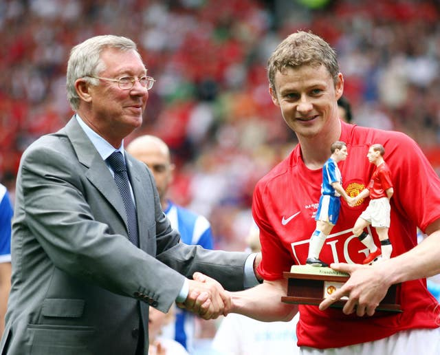 Solskjaer takes a different approach to management than his old mentor Sir Alex Ferguson, left