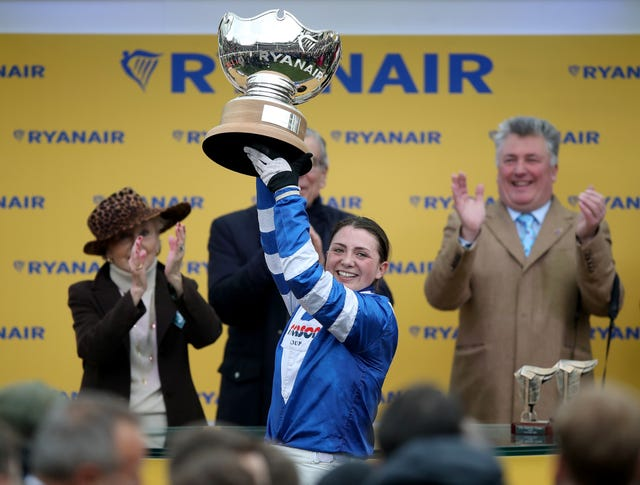 Paul Nicholls watches on as Bryony Frost lifts the Ryanair Trophy