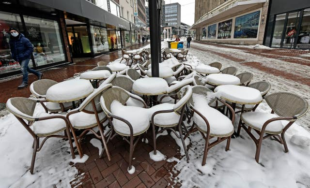 Chairs are covered with snow during the lockdown when all bars and restaurants are closed at Gelsenkirchen, Germany (Martin Meissner/AP)