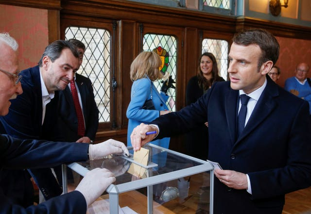 French president Emmanuel Macron casts his ballot in the mayoral elections in Le Touquet in northern France