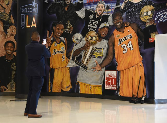 An attendee took a photo of a mural featuring Kobe Bryant inside the Staples Center