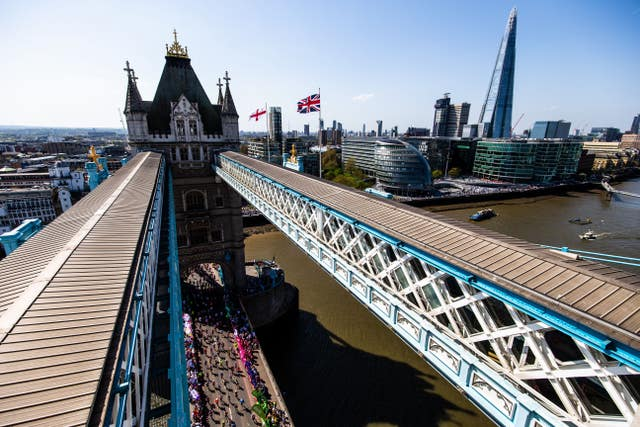 Runners make their way over Tower Bridge during a baking hot 2018 London Marathon