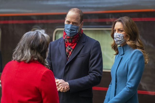 William and Kate are met by Deputy Lord Lieutenant Sandra Cumming as they arrive by train at Edinburgh Waverley Station during their royal train tour. Andy Barr/PA Wire