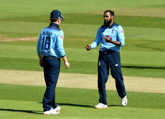 Adil Rashid, right, celebrates with captain Eoin Morgan after taking the wicket of Ireland's Kevin O'Brien