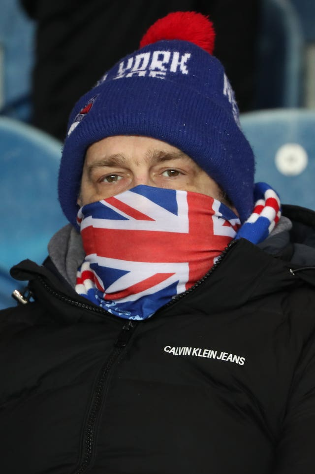 A Rangers fan wore an improvised mask ahead of the European tie