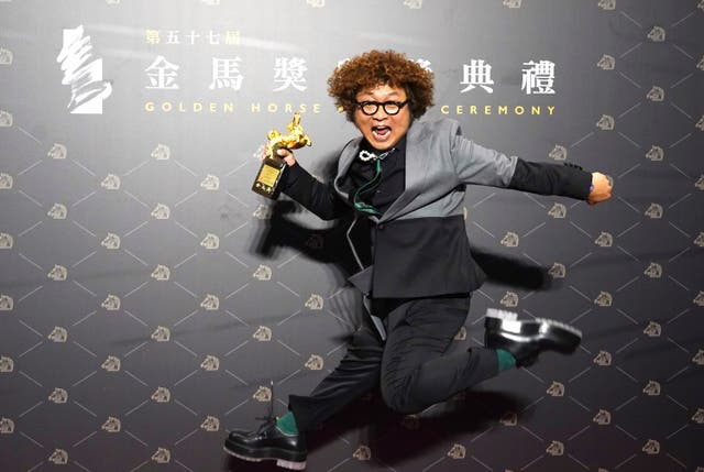 Taiwanese actor Nadow Lin holds his best supporting actor trophy at the 57th Golden Horse Awards in Taipei, Taiwan