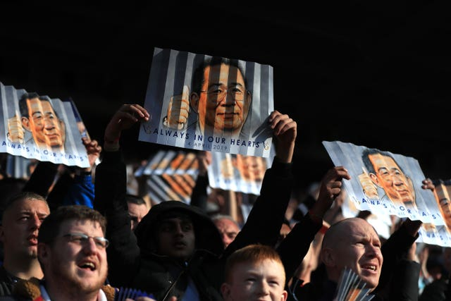 Leicester City fans hold up banners in honour of late chairman Vichai Srivaddhanaprabha (Mike Egerton/PA)