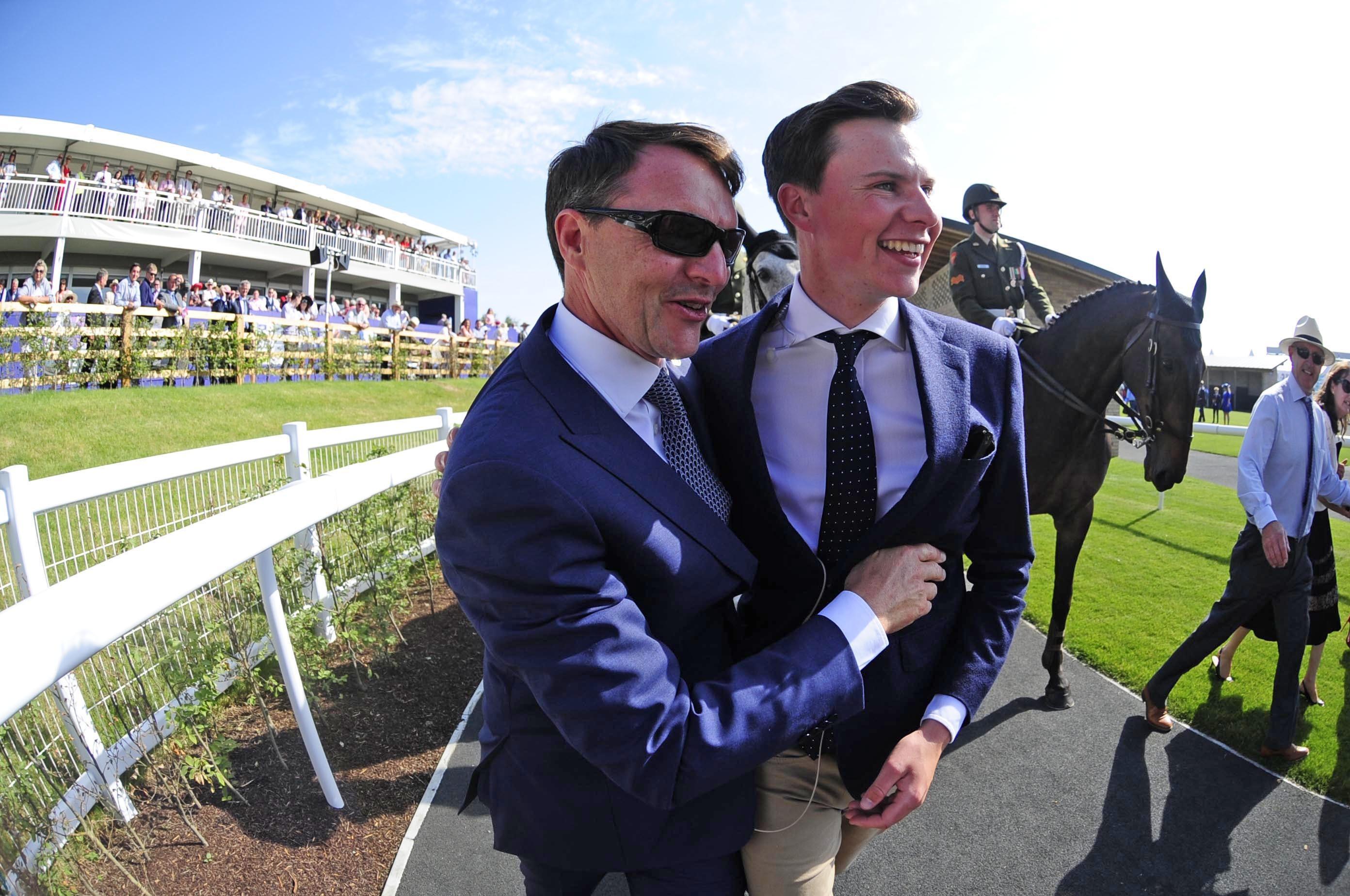 Aidan O'Brien congratulates his son Joseph after the Irish Derby