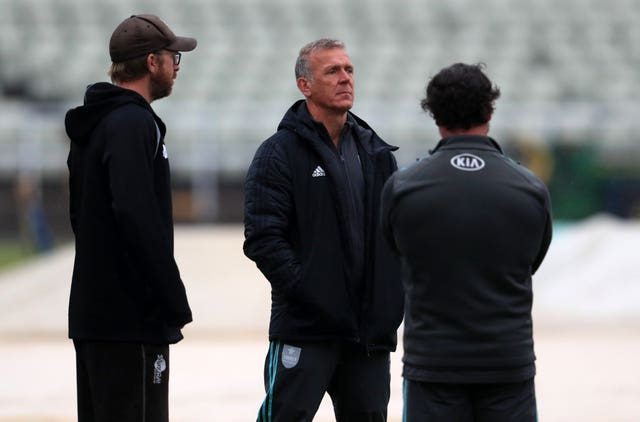 Surrey's director of cricket Alec Stewart assesses the sodden outfield.