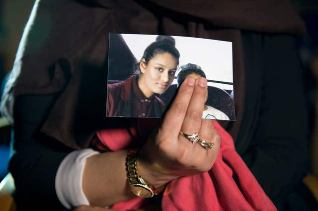 Renu, eldest sister of Shamima Begum holds her sister's photo