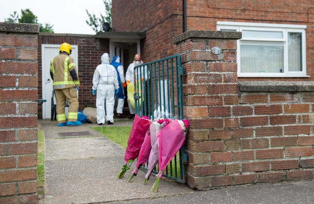 Floral tributes outside a flat on Oxford Avenue in Gorleston-on-Sea, Norfolk after the bodies of a man and a woman were discovered in the property