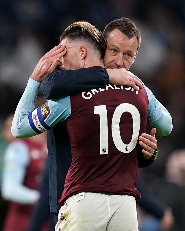 Jack Grealish is consoled by assistant manager John Terry