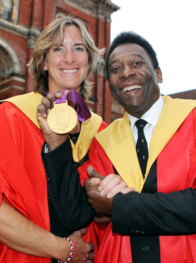 Olympic Gold medal rower Katherine Grainger, a graduate of Edinburgh University, stands with former footballer Pele, who was presented with an honorary degree by the university