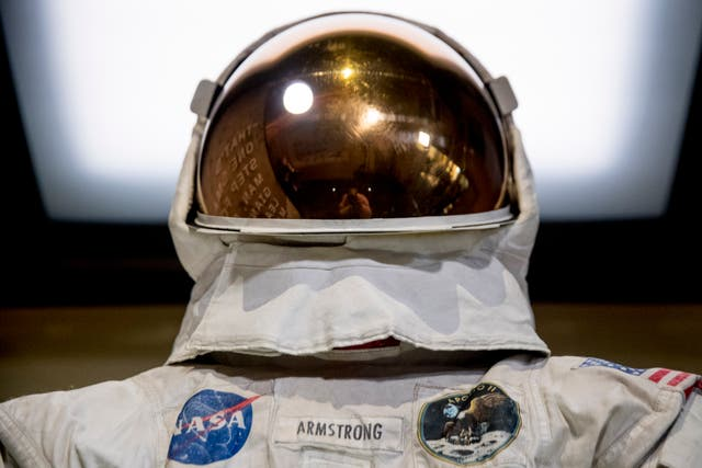 Neil Armstrong's Apollo 11 spacesuit is unveiled at the Smithsonian's National Air and Space Museum on the National Mall in Washington