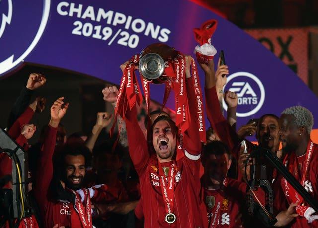 Jordan Henderson holds aloft the Premier League trophy
