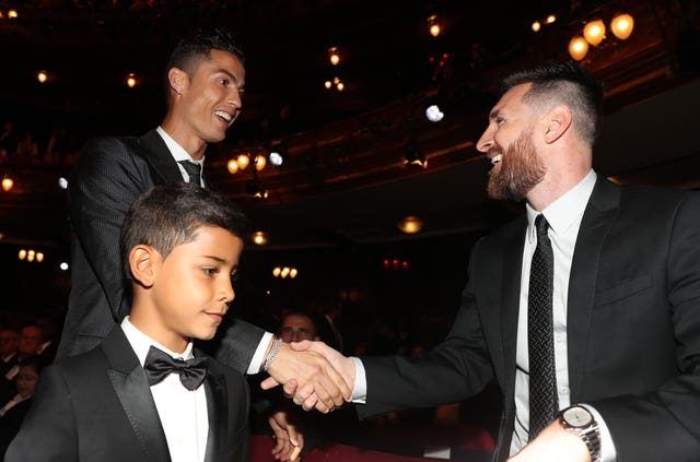 Lionel Messi greets Cristiano Ronaldo, left, at 2017's The Best FIFA Football Awards