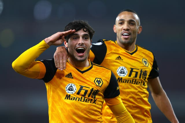 Pedro Neto (left) celebrates scoring his side's first goal