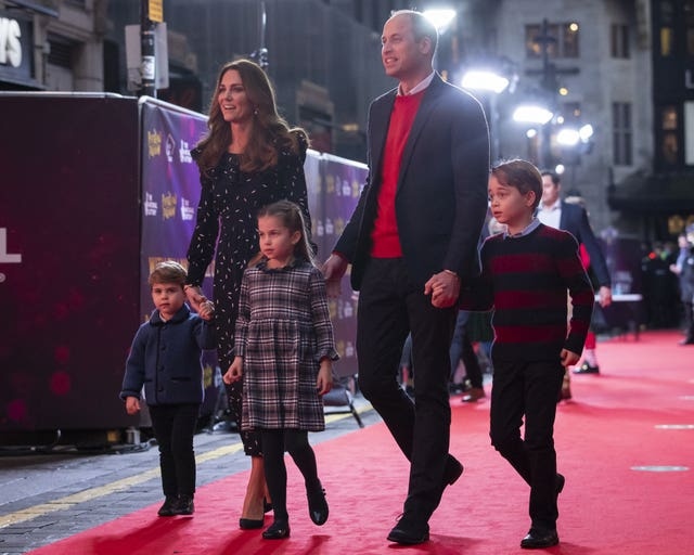 The Duke and Duchess of Cambridge and their children attend a special pantomime performance at London's Palladium Theatre