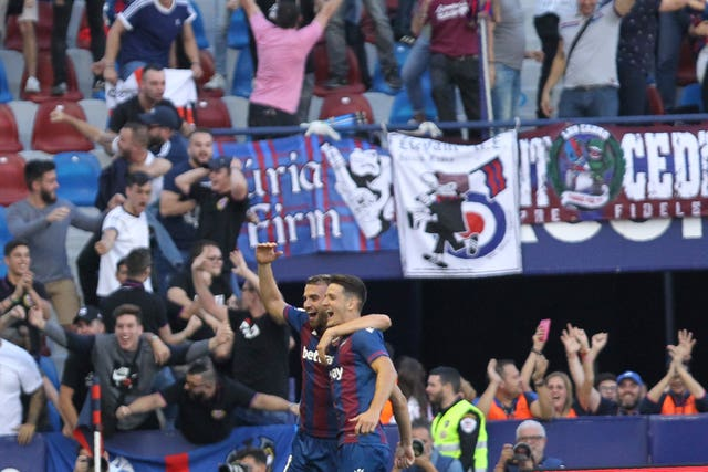 Levante's players and fans celebrate their third goal during Saturday's shock win against Barcelona