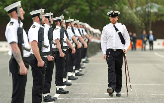 A Royal Navy Petty Officer measures the distances between members of the unit (Andrew Matthews/PA)