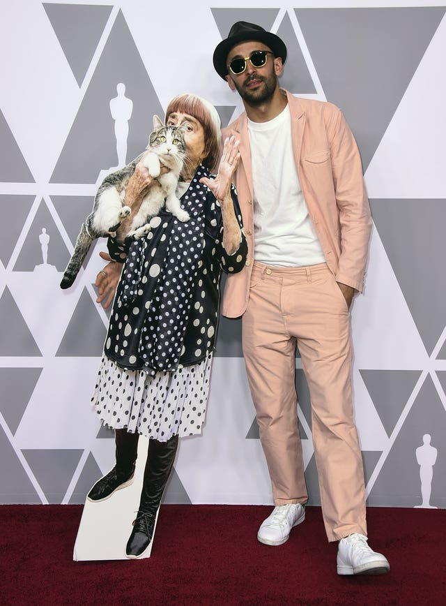 JR, right, poses with a cut-out of Agnes Varda