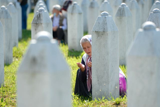 A woman prays in Potocari, near Srebrenica