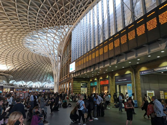People waiting inside King's Cross station
