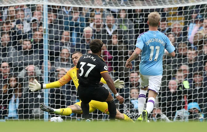 Adama Traore scored twice as Premier League champions Manchester City suffered a shock 2-0 home defeat by Wolves.