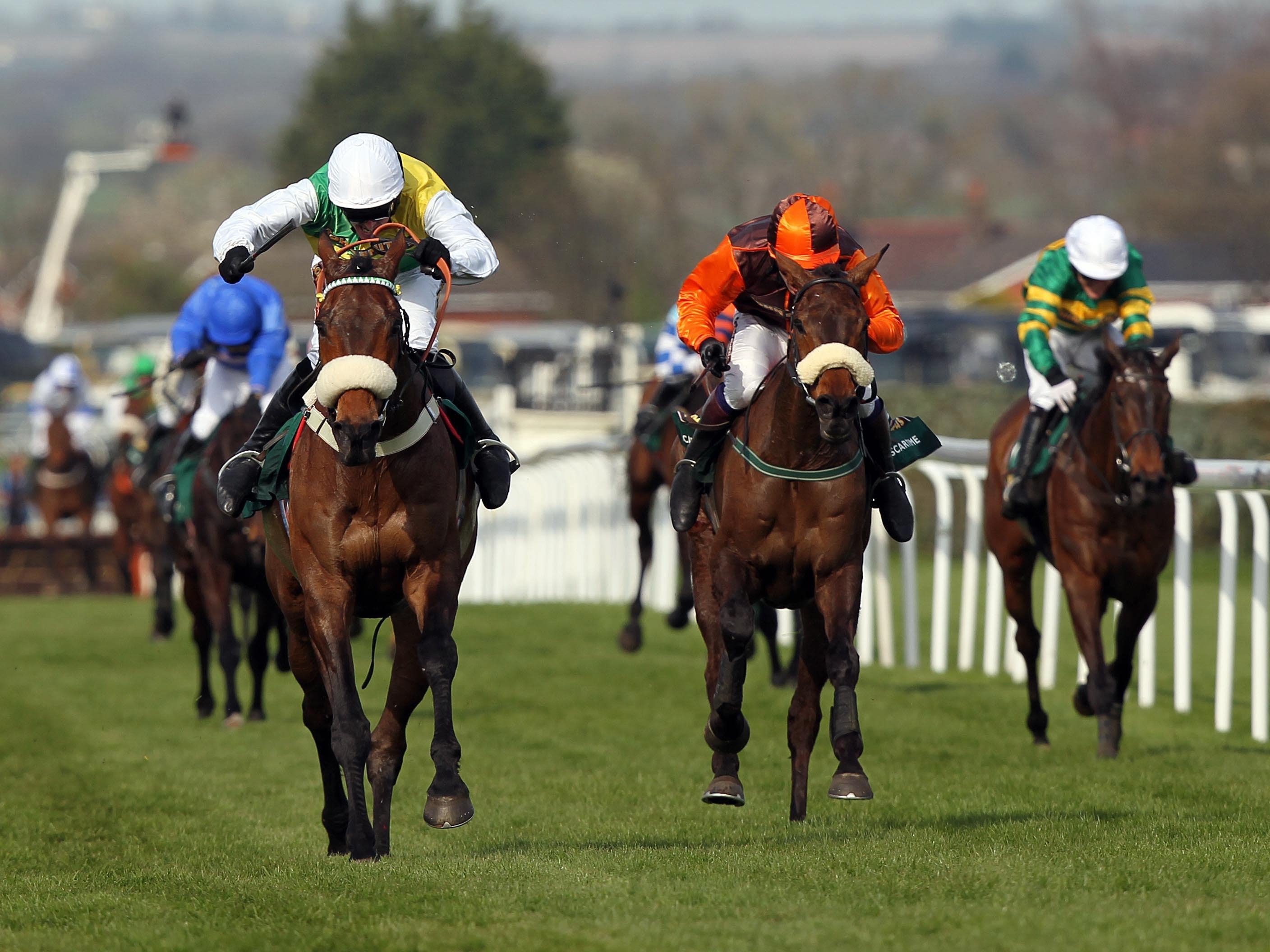 Ballabriggs, ridden by Jason Maguire (left), winning the 2011 Grand National (David Davies/PA)