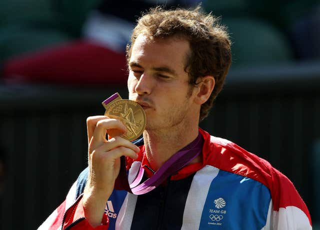 Andy Murray celebrates the first of his two Olympic golds