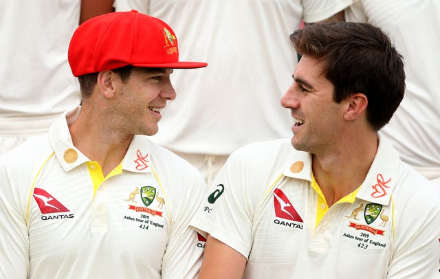 Australia's Tim Paine, left, wearing the red cap which will be worn on day two