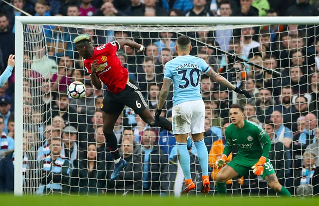 Paul Pogba scored twice as Manchester United came back to deny City