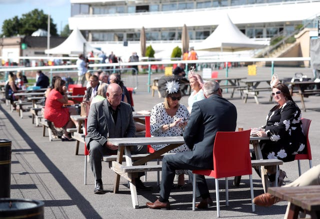 Racegoers at Doncaster on the first day of the St Leger meeting