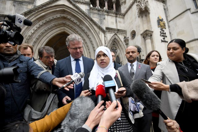 Shelina Begum and Mohammed Raqeeb (right) outside the Royal Courts of Justice
