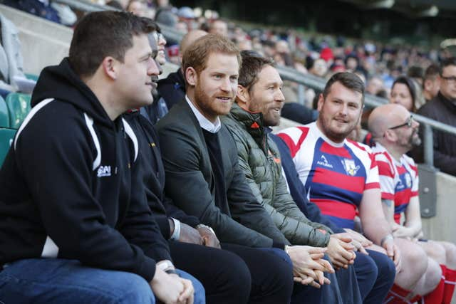 Prince Harry (centre left) with former England player Jonny Wilkinson (centre right) during a visit to the England rugby team open training session at Twickenham Stadium in London. (Heathcliff O'Malley/The Daily Telegraph)