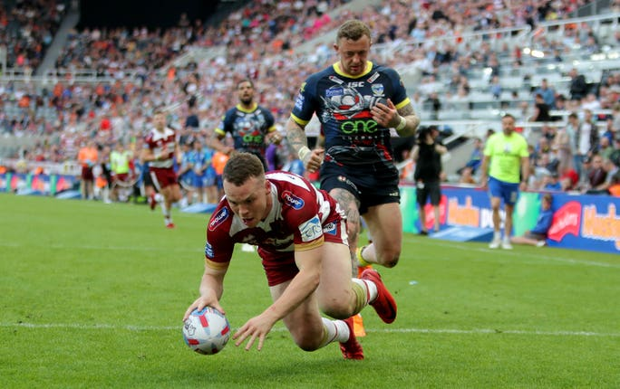 Wigan's Liam Marshall scores a try