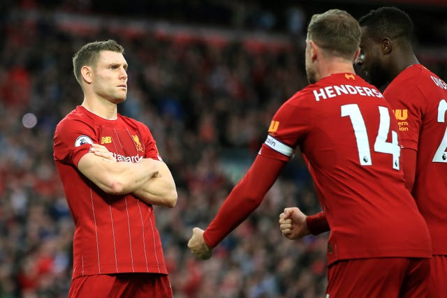 James Milner, left, celebrates a successful penalty against Leicester