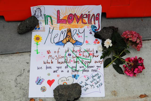 A message is displayed at a makeshift memorial outside Christchurch hospital