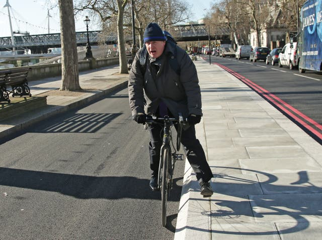 Boris Johnson cycling back when he was Mayor of London
