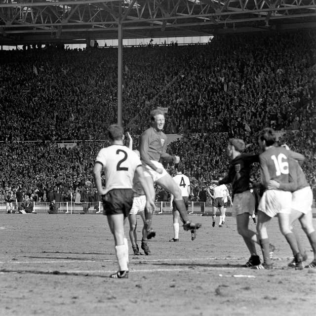 Jack Charlton leaps in the air as he celebrates England's World Cup win